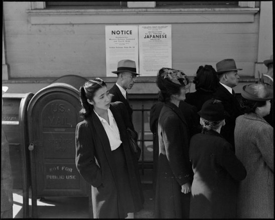 Residents of Japanese ancestry appear for registration prior to evacuation.